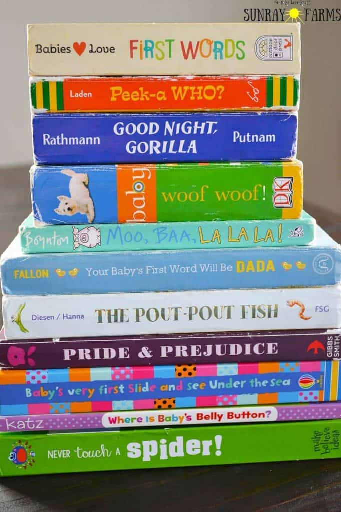 A stack of board books for one year olds- First Words, Peek-a-WHO?, Good Night, Gorilla, Baby Woof Woof, Moo, Baa, La La La, Your Baby's First Word Will Be Dada, The Pout-Pout Fish, Pride & Prejudice, Baby's Very First Slide and See Under the Sea, Where is Baby's Belly Button?, Never Touch a Spider!