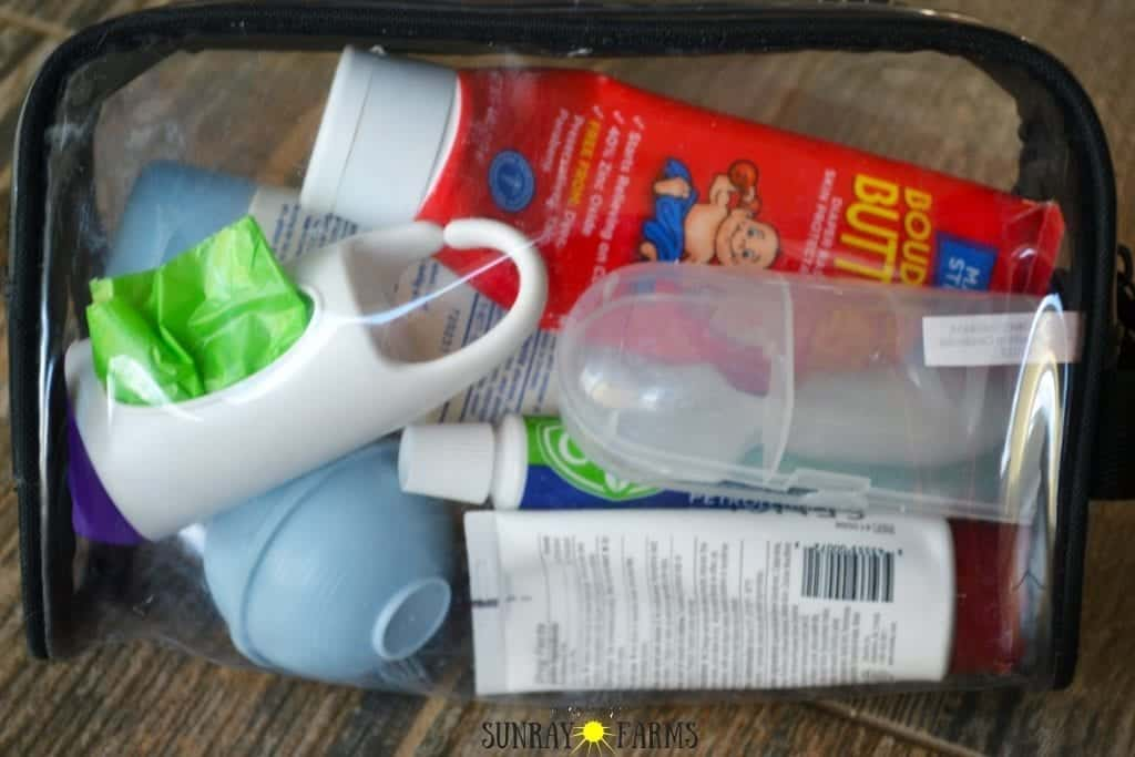 Clear plastic makeup bag used to hold diapering supplies in a diaper bag