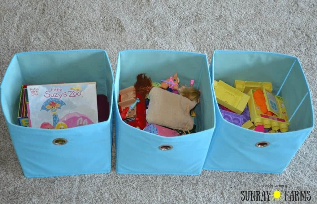 Toys in storage bins that are kept in the bedroom.