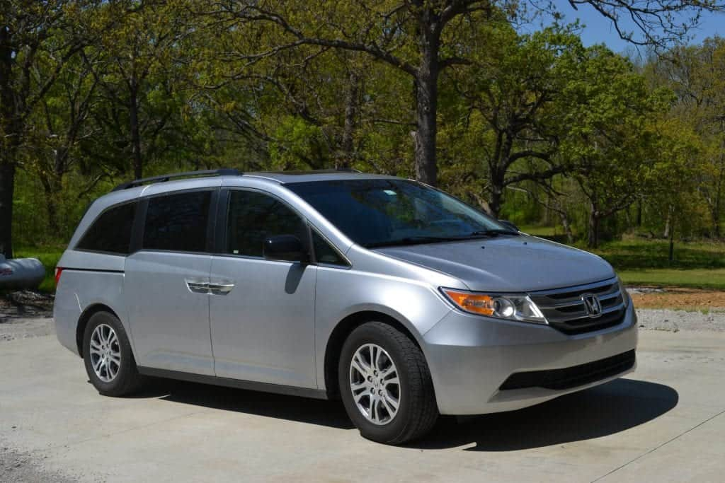Silver minivan in a driveway
