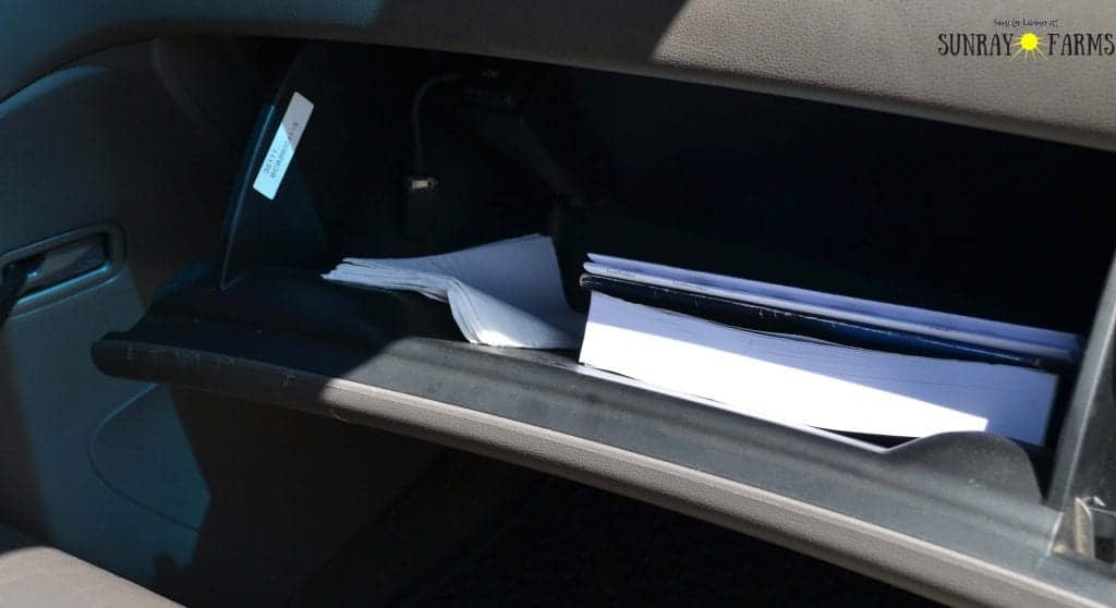 Organized glove compartment of a car.